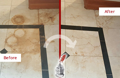Before and After Picture of a Mountain Lakes Hard Surface Restoration Service on a Marble Floor to Eliminate Rust Stains